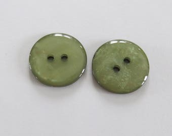 Large buttons * green circles with two holes