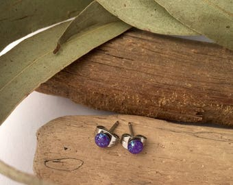 New improved waterproof design! Itty bitty, purple eco-resin studs with iridescent sparkles of reflective glitter.
