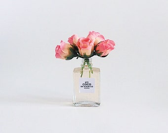 """5"""" pink rose buds in Champagne perfume inspired vase"""