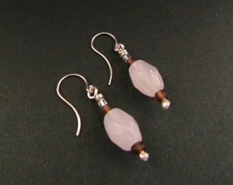 Sterling silver hand crafted dangle earrings with pinkish quartz gems.