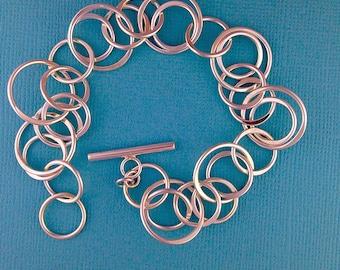 Multi -Ring Sterling Silver Bracelet