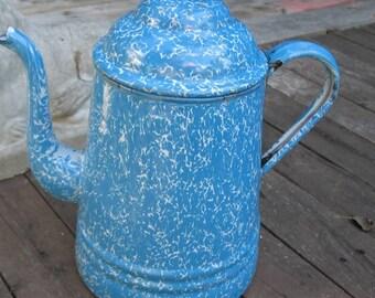 White and blue enamel vintage teapot.