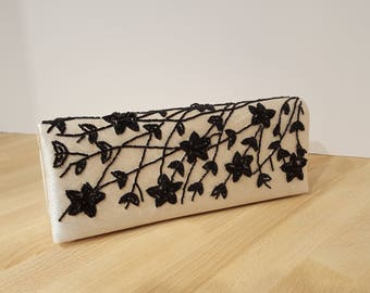 Bijoux Terner Black and Ivory Floral Beaded Clutch Handbag with Snap Closure presented by Donellensvintage