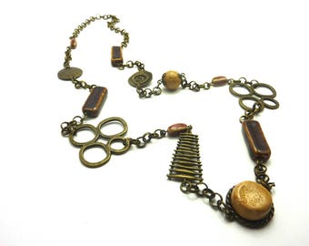 Necklace with ceramic and polymer clay beads and bronze finishes
