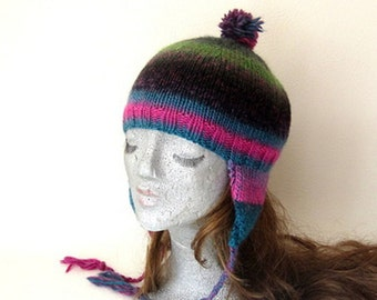 knitted hat with earflaps in pink and blue.  hat. with pompoms.  Yarnawayknits