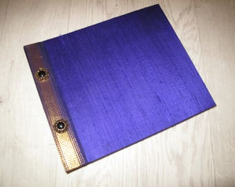 Vintage photo album with purple raw silk cover