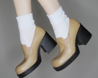 90s rampage platform loafer heels all man made materials listed as a size 7.5