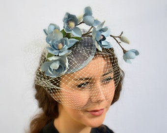 Kentucky Derby Hat MOONLIGHT GREY FASCINATOR  with elegant blueish grey cascading flowers and cream veil, handmade with care by Jaine.