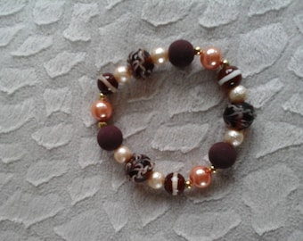 Brown and orange glass beaded bracelet