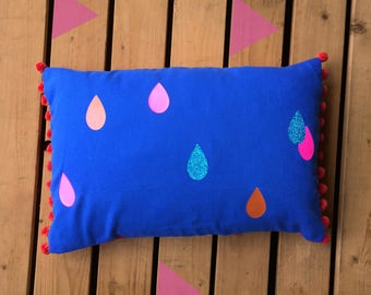 Blue tropical Cushion. Raindrops pillow pattern with neon pink, glitter on Royal blue with pompoms. Colour lover home