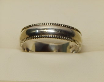 STERLING SILVER RING, with tiny raised dots on each edge. Lightly worn, about size 6