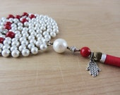 Long white and red neckla...
