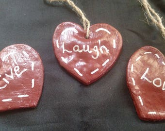 Heart shaped ornament with the saying Laugh