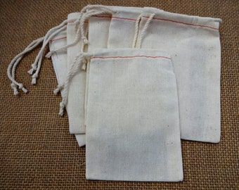 Set of (6) white muslin drawstring bags, 3.5 x 5 inches.  Rubberstamp or adorn with ribbon to create DIY gift bags for small items.