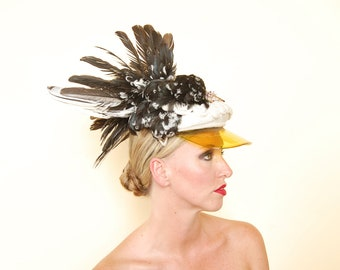Le Roth: Taxidermy rooster on visor cap