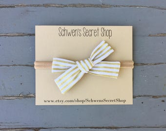 Gold striped bow, hand tied bow, baby girl headband, baby girl bow, nylon headband, baby headband, baby hair bow, baby bow headband