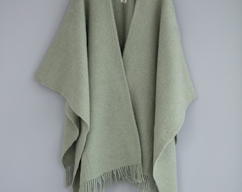 Two-tone green wool poncho, hand-made with two needles. Unisex
