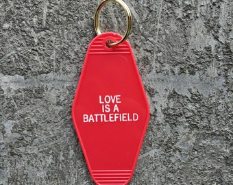 Love Is A Battlefield Hotel Key Fob with Brass Ring Homage to Pat Benatar Motel Key