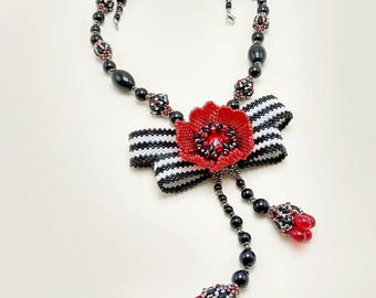 Bow poppy necklace, beaded jewelry, black white red pendant, graphical bright edwardian lariat, handmade oldfashion beadwork, beaded tassel