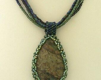 Green Jasper Teardrop Reversible Pendant with Beadwoven Bezel by Carol Wilson of Je t'Adorn