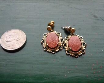 Goldstone earrings in gold metal