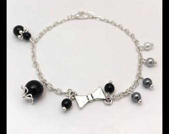 Bracelet 'bowtie' and black glass beads