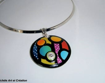 multicolored round pendant and dots of polymer clay