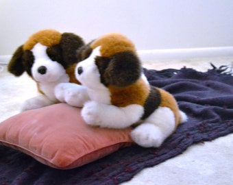"GUND ( 2 ) ST. BERNARDS, 1985.  They are Tan & White with dark Brown. Noses are leather with Glass Eyes 22"" from head to tail. Perfect Cond."