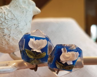 Vintage White Rose screw back earrings w blue back ground and green leafs with clear Lucite They are hand carved hand painted 1 inch