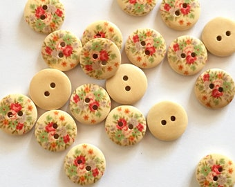 5 wooden buttons with painted floral pattern