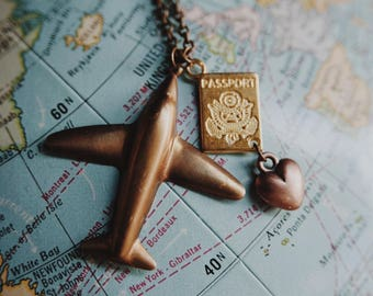 wanderlust II.  a whimsical raw brass airplane and passport necklace for travel lovers