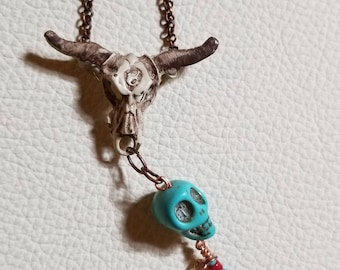 Southwest inspired hand painted cow skull charm with skull, beads and heart.
