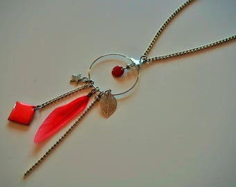 Metal necklace featuring a feather and coral enamel beads