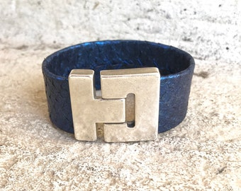 Wide Metallic Blue salmon leather cuff bracelet with magnetic clasp.