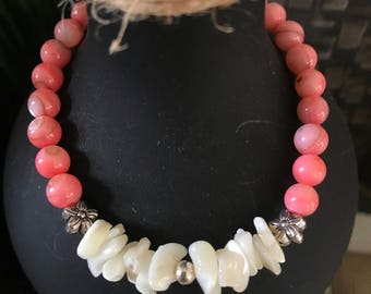 Coral beaded bracelet with fresh water pearl and silver accents.  6mm beads.   Looks great stacked with multiple bracelets!