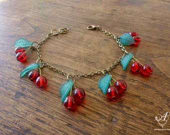 Bracelet with red cherries charms with leaves dark or light green in color bronze metal - rockabilly / pinup / kawaii - cherry jewel