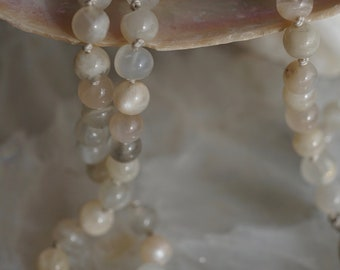 Moonstone 108 Plus ! Guru Bead Mala on a Silk Cord with a Small Silver Plated Moon Charm and Tassel