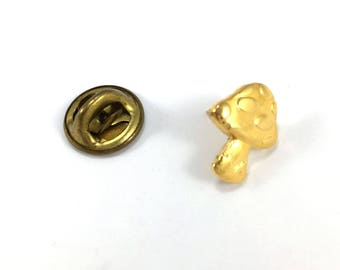 Gold coloured toadstool lapel badge
