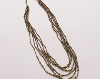 Long Gold Multi-Strand Paper Bead Necklace