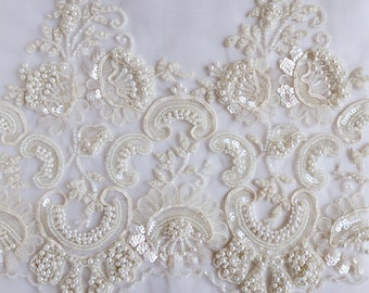 Hand-made wedding trim beaded richly with pearls, ribbons and sequins