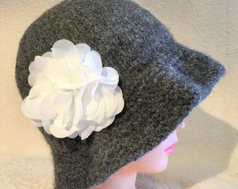 Charcoal gray heather hand knit felted wool cloche hat with ruffled brim and attached fabric white rosette
