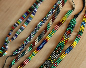 Small Native American bracelets woven with seed beads