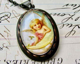 Angel on the Moon necklace made with Fallen Angel Brass, handmade glass cabochon, black antiqued brass, angel pendant, cherub charm, wings