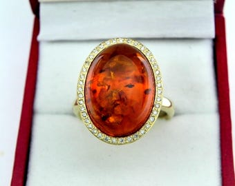AAAA Amber 18x13mm  5.43 Carats   14K Yellow gold Diamond halo cabochon ring. 1525