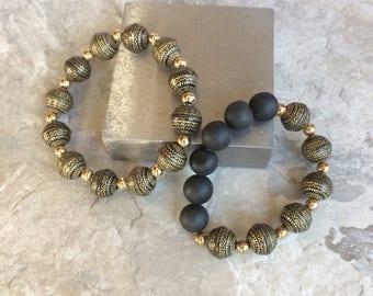 Petite black and gold beaded stretch bracelets