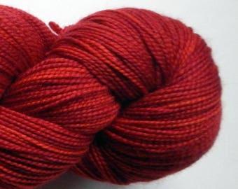 Hand dyed red 100% merino superwash sock yarn
