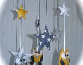 Mobile owls and stars yellow and gray