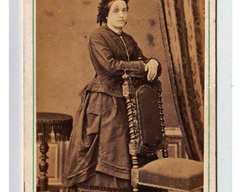 My Spot - antique CDV photograph of a young lady standing by an ornate chair - early 1870s full length fashion study - French studio