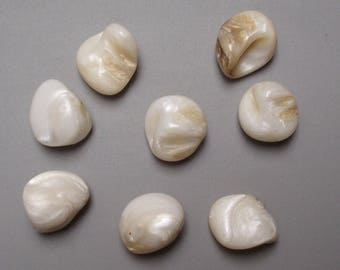 Set of 8 natural mother of pearl beads are drilled.