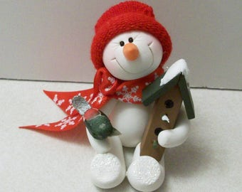 My sweet little friend: Snowman ornament with his bird and bird house
